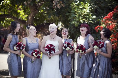 Bridesmaids in silver dupioni dresses with red bouquets   Dramatic 1930's Inspired Red and Gray Wedding