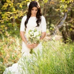 Elegant Lace Wedding Dress with a Simple Woodsy Bouquet | Romantic Forest Bridal Portraits by Brandon Burk