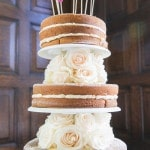 Naked Cake Decorated with White Roses and a Handmade Cake Topper | Roxana Albusel Photography