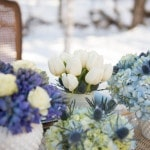 Elegant Blue and White Winter Centerpieces | Carla Ten Eyck Photography | Winter Chic - Cozy White and Blue Snowy Forest Wedding