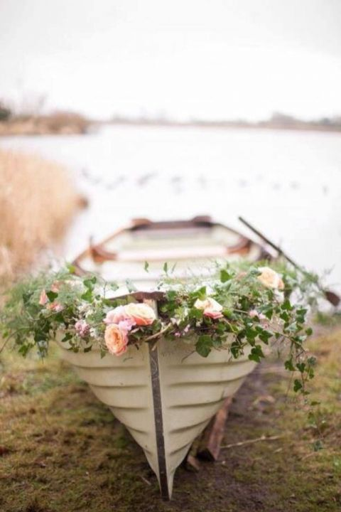 Garland Draped Rowboat | Ashley O'Dwyer