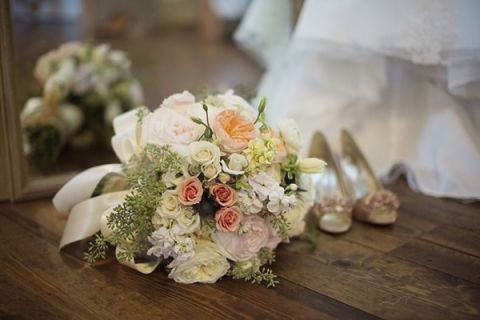 Blush and Ivory Bouquet with the Bride's Dress and Shoes | Barefeet Photography | see More: http://heyweddinglady.com/blush-and-ivory-spring-wedding-at-thistle-springs-ranch-from-barefeet-photography/