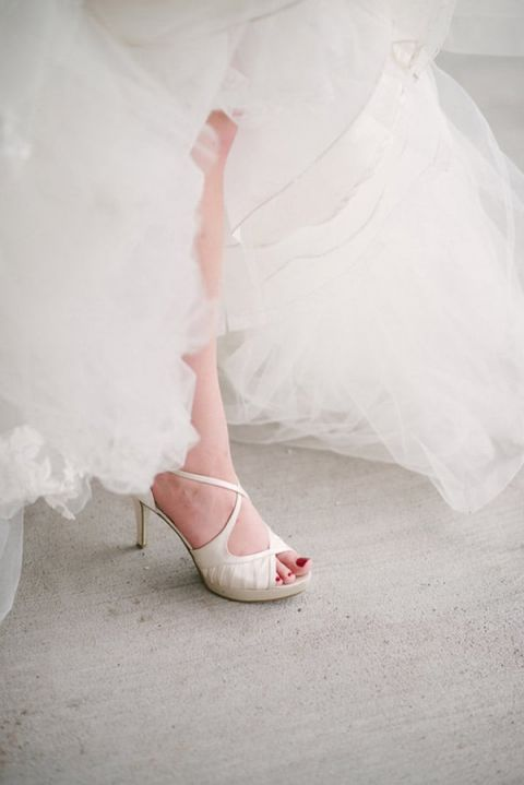 Fabulous Pearl Wedding Shoes | Milton Photography | See More: https://heyweddinglady.com/ruby-and-gray-wedding-with-vintage-book-details-from-milton-photography/