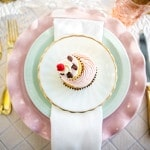 Petite Cupcakes on a Pastel Pink and Aqua Place Setting | Maru Photography | See More: https://heyweddinglady.com/sweeter-than-candy-retro-valentines-day-styled-shoot-in-pastel-hues-from-maru-photography/