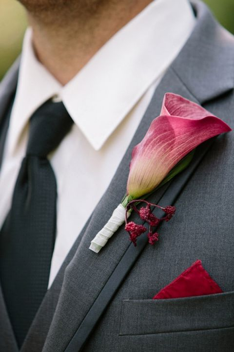 Garnet Calla Lily Boutonniere | Milton Photography | See More: https://heyweddinglady.com/ruby-and-gray-wedding-with-vintage-book-details-from-milton-photography/