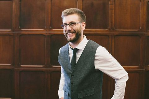 Dapper Groom in a Gray Vest | Robert J Hill Photography | See More: http://heyweddinglady.com/simple-and-elegant-grand-bohemian-hotel-wedding-from-robert-j-hill-photography/
