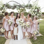 Bridesmaids in Blush and the Cutest Flower Girl Ever! | Barefeet Photography | see More: https://heyweddinglady.com/blush-and-ivory-spring-wedding-at-thistle-springs-ranch-from-barefeet-photography/