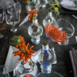 Modern and Eclectic Orange and Gray Wedding Centerpieces | Carla Ten Eyck Photography | See More: https://heyweddinglady.com/industrial-modern-loft-wedding-shoot-by-carla-ten-eyck/