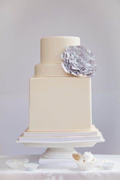 Petite Ivory Wedding Cake with a Periwinkle Flower | Blue Note Bakery
