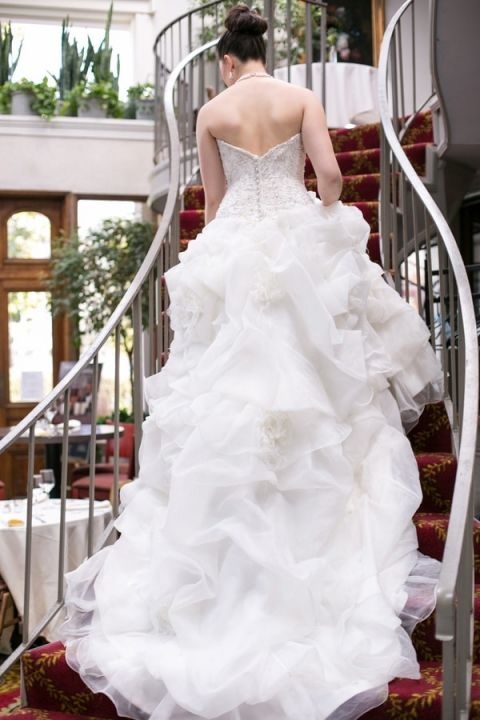 Cascading Ruffles for an Elegant Wedding Gown Train | StarNoir Photography | See More! https://heyweddinglady.com/classic-french-wedding-style-in-black-and-white/