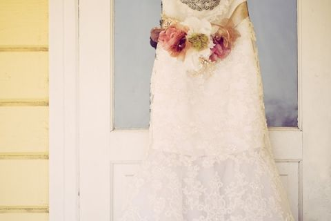 Sweetheart Lace Wedding Dress with Floral Sash | Ashley DePencier Photography | See More: https://heyweddinglady.com/country-romance-pastel-spring-wedding-inspiration-from-ashley-depencier-photography/