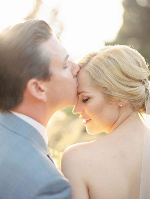 Sweet Kisses on a Summer's Day | Ashley Kelemen Photography | See More: http://heyweddinglady.com/liquid-gold-need-magic-hour-portraits-wedding/