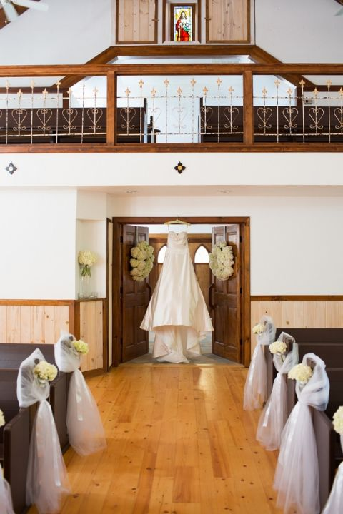 Wedding Dress in the Mountain Chapel at Chota Falls | Cariad Photography | See More: https://heyweddinglady.com/spring-green-southern-wedding-with-a-travel-theme/
