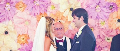 Soft Citrus Paper Flower Ceremony Backdrop | Harwell Photography | See More: https://heyweddinglady.com/love-bloom-gorgeous-paper-flower-ideas-wedding/