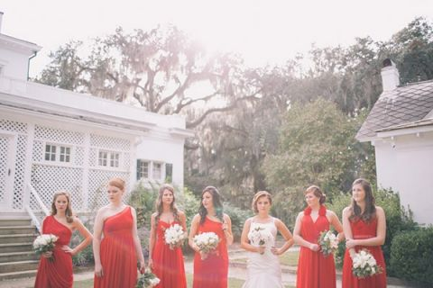 Bridesmaids in Cherry Red with Different Silhouettes | Black and Hue Photography | See more: https://heyweddinglady.com/cherry-red-black-and-ivory-rustic-chic-wedding-from-black-and-hue-photography/