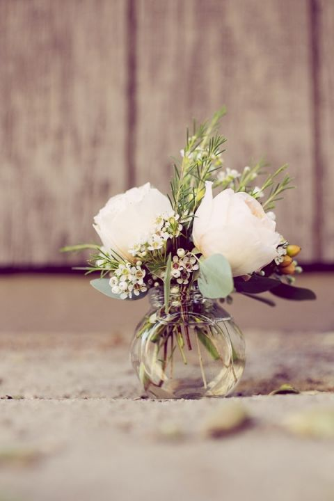 Peach Rosebuds in a Bud Vase | Ashley DePencier Photography | See More: https://heyweddinglady.com/country-romance-pastel-spring-wedding-inspiration-from-ashley-depencier-photography/