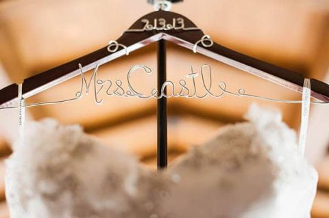 A custom monogram dress hanger for the bride | Luxury Estate Weddings and Events | See more! https://heyweddinglady.com/tuscan-inspired-hilltop-villa-wedding-in-malibu/