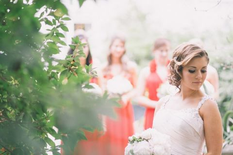 Classic Bridal Style with Bridesmaids in Red | Black and Hue Photography | See more: https://heyweddinglady.com/cherry-red-black-and-ivory-rustic-chic-wedding-from-black-and-hue-photography/