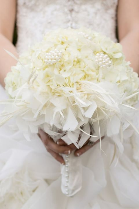 An All White Bridal Bouquet with Pearls and Feathers | StarNoir Photography | See More! https://heyweddinglady.com/classic-french-wedding-style-in-black-and-white/