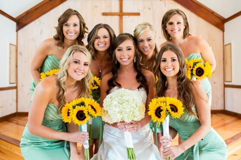Bridesmaids in Spring Green with Sunflowers! | Cariad Photography | See More: https://heyweddinglady.com/spring-green-southern-wedding-with-a-travel-theme/
