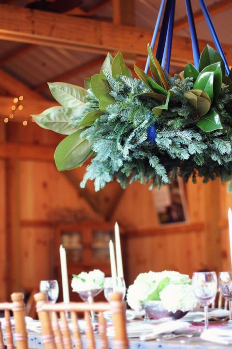 Hanging Greenery Chandelier for a Romantic, Rustic Barn Wedding | dKin Photography | See More https://heyweddinglady.com/local-sustainable-wedding-ideas-family-run-vineyard-dkin-photography/
