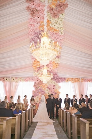 Elegant Tented Wedding Ceremony with a Paper Flower Backdrop | Harwell Photography | See More: https://heyweddinglady.com/love-bloom-gorgeous-paper-flower-ideas-wedding/