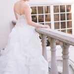 Amazing Ruffled Wedding Dress and a Sparkling Brooch for a Bridal Updo | StarNoir Photography | See More! http://heyweddinglady.com/classic-french-wedding-style-in-black-and-white/