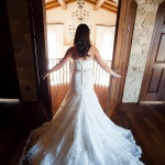 Elegant Wedding Dress with a Lace Train | Luxury Estate Weddings and Events | See more! http://heyweddinglady.com/tuscan-inspired-hilltop-villa-wedding-in-malibu/