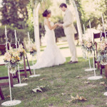 Romantic Spring Country Ceremony with Roses Lining the Aisle | Ashley DePencier Photography | See More: https://heyweddinglady.com/country-romance-pastel-spring-wedding-inspiration-from-ashley-depencier-photography/