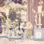 Ribbon Streamers Decorate a Sweetheart Table for a Country Chic Wedding | Ashley DePencier Photography | See More: https://heyweddinglady.com/country-romance-pastel-spring-wedding-inspiration-from-ashley-depencier-photography/