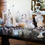 Glass Apothecary Jars on a Kings Table for an Elegant Candy Bar | Luxury Estate Weddings and Events | See more! https://heyweddinglady.com/tuscan-inspired-hilltop-villa-wedding-in-malibu/