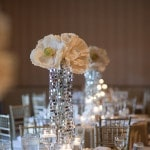 Paper Poppy Centerpieces top a Column of Glittering Crystals | Tikko Weddings |See More: https://heyweddinglady.com/classic-and-glamorous-blush-and-gold-socal-wedding-from-tikko-weddings/