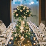 Slate Blue and Ivory Farm Tables for an Elegant Barn Reception by Candlelight | Black and Hue Photography | See more: http://heyweddinglady.com/cherry-red-black-and-ivory-rustic-chic-wedding-from-black-and-hue-photography/