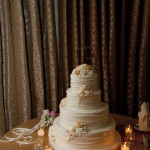 Glamorous Ivory and Gold Wedding Cake | Tikko Weddings |See More: https://heyweddinglady.com/classic-and-glamorous-blush-and-gold-socal-wedding-from-tikko-weddings/