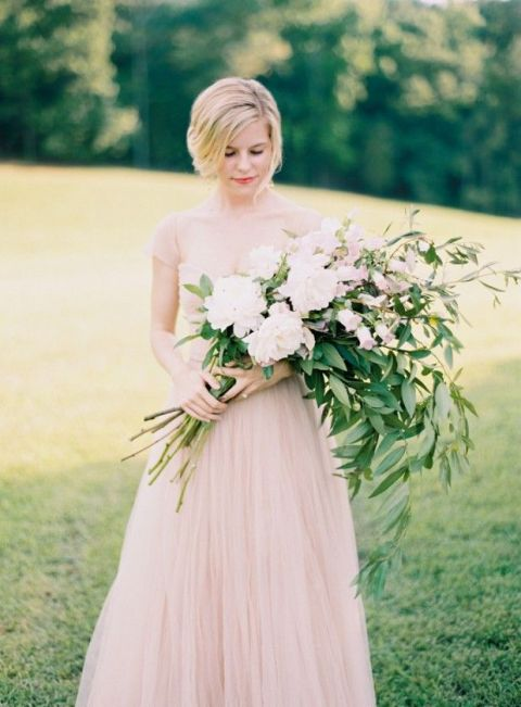 A Blush Wedding Dress and Wild Foliage Bouquet | Landon Jacob Photography | See More! https://heyweddinglady.com/down-the-garden-path-a-forest-green-and-peach-wedding/