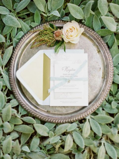 Letterpress Wedding Invitation and a Vintage Silver Tray on a Bed of Greenery | Michele Beckwith Photography | See More! https://heyweddinglady.com/down-the-garden-path-a-forest-green-and-peach-wedding/