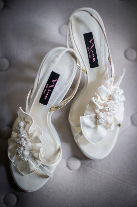 Ruffled White Wedding Shoes | Carla Ten Eyck | See More! http://heyweddinglady.com/joyful-peach-and-spring-green-connecticut-wedding/