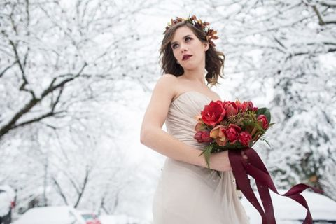 Winter Queen - Snowy Winter Wedding Portraits with Crimson Amaryllis | Angela Hubbard Photography | See More! https://heyweddinglady.com/winter-queen-snowy-bridal-portraits-by-angela-hubbard-photography/