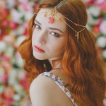 Flowing Wavy Hair and A Boho Chic Bridal Crown | Warmphoto | See More! http://heyweddinglady.com/flowers-and-feathers-boho-coral-charm-bridal-inspiration-from-warmphoto/
