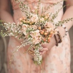 Peach Blooms and a Floral Bridesmaid's Dress | Bit of Ivory Photography | See More! http://heyweddinglady.com/hitched-rustic-romance-wedding-inspiration-orchestrated-stylized-shoots/