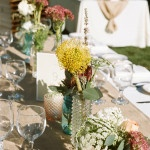 Eclectic bottles and colorful wildflowers for a California chic wedding | Tikko Weddings | See More! https://heyweddinglady.com/elegant-and-colorful-wine-country-wedding/