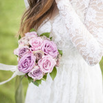 Vintage Lace Wedding Dress with Purple Sterling Roses | Plenty to Declare Photography | See More! https://heyweddinglady.com/romantic-english-bohemian-bridal-shoot-from-plenty-to-declare-photography/