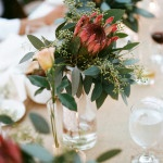 Protea and eucalyptus centerpieces in vintage blue mason jars | Tikko Weddings | See More! https://heyweddinglady.com/elegant-and-colorful-wine-country-wedding/