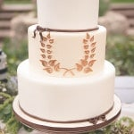 A Horseshoe Shaped Wreath Wedding Cake | Bit of Ivory Photography | See More! http://heyweddinglady.com/hitched-rustic-romance-wedding-inspiration-orchestrated-stylized-shoots/