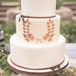 A Horseshoe Shaped Wreath Wedding Cake | Bit of Ivory Photography | See More! https://heyweddinglady.com/hitched-rustic-romance-wedding-inspiration-orchestrated-stylized-shoots/