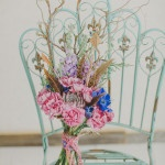 A Bohemian Inspired Wildflower and Feather Bouquet | Warmphoto | See More! http://heyweddinglady.com/flowers-and-feathers-boho-coral-charm-bridal-inspiration-from-warmphoto/