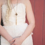 Floral Lace Wedding Dress with a Delicate Peplum and Western Inspired Necklace | Bit of Ivory Photography | See More! https://heyweddinglady.com/hitched-rustic-romance-wedding-inspiration-orchestrated-stylized-shoots/