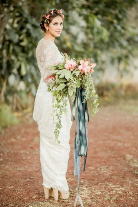 Hibiscus Pink Bridal Bouquet Tied with Watercolor Ribbons | Jose Villa | See More! https://heyweddinglady.com/southern-comfort-relaxed-and-romantic-azure-blue-wedding/