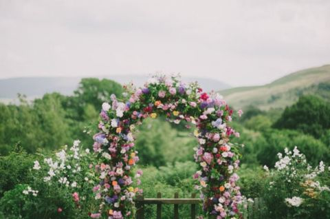 Bright and Cheerful Colorful Floral Arch for a Garden Wedding | Kitchener Photography | See More: https://heyweddinglady.com/casual-and-colorful-summer-wedding-inspiration-based-on-grant-harrison/