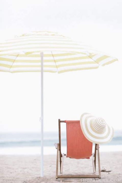 Pale Coral Retro Beach Chair and Striped Umbrella | Preppy in Poppy | See More! https://heyweddinglady.com/preppy-in-poppy-seaside-summer-wedding-inspiration/